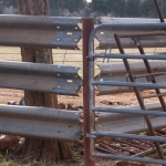 Great visual of how to intersect two lines of used guardrail joining at an angle. What a great place to locate a gate at the same point, as the stress of the corral hinge point could be carried by the used highway guardrail very easily.