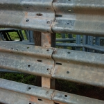 The stout guardrail posts hold up the panel… and the panel links the entire fence system together with three powerful corrugated rows.