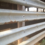 Add a wall to the barn by simply bolting the guardrail panel to the poles of the barn. VERY fast and easy – and no bull gonna knock this down.